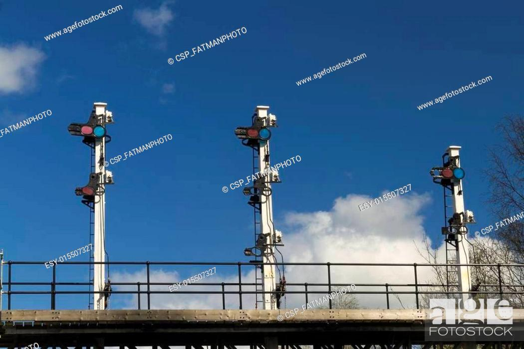 Stock Photo: Shunting signals on gantry over railway line.