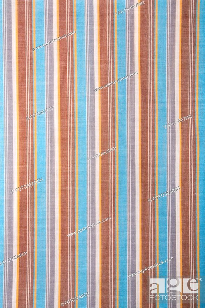 Stock Photo: Close-up of woven vintage fabric with blue and brown stripes on cotton.