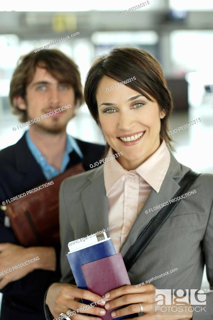 Stock Photo: Man and woman at airport.