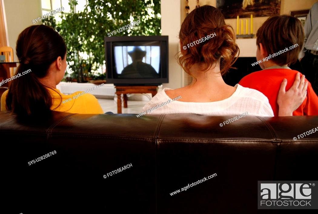 Stock Photo: Mother watching television with children.