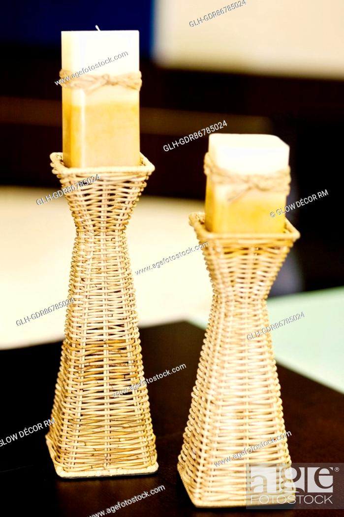 Photo de stock: Candlestick holders with candles on a table.