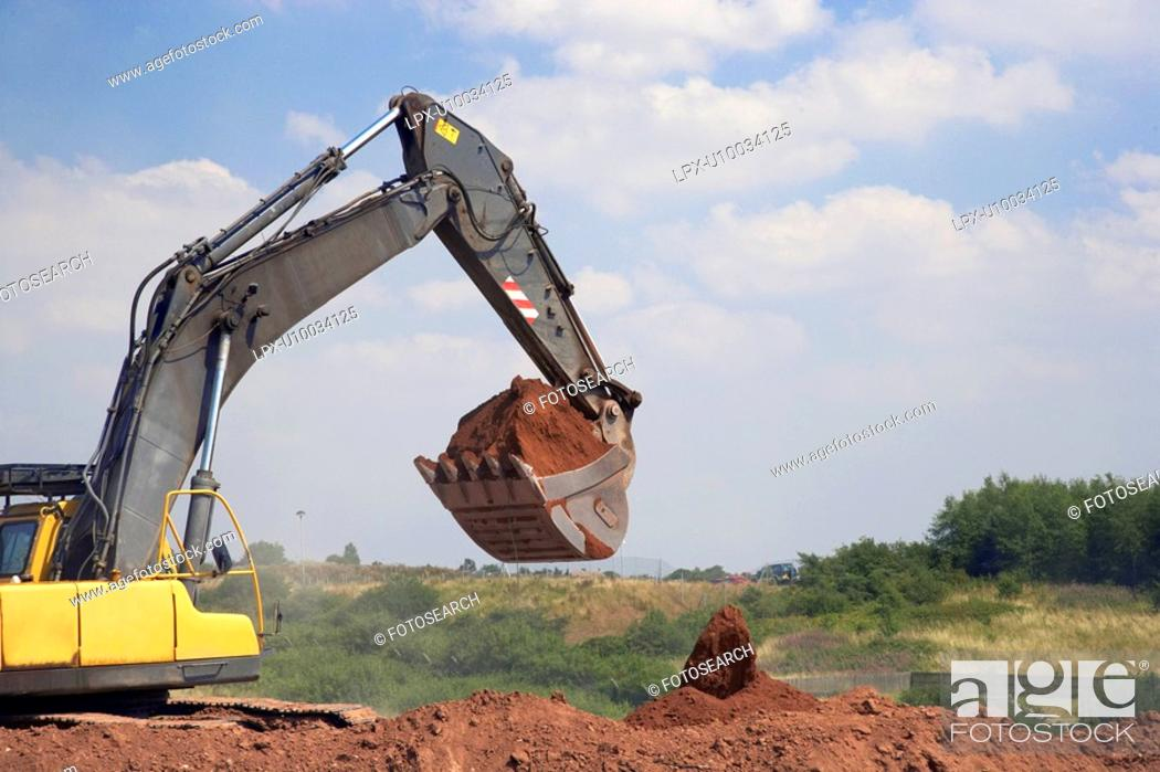 Stock Photo: Excavator working on a contaminated land remediation.