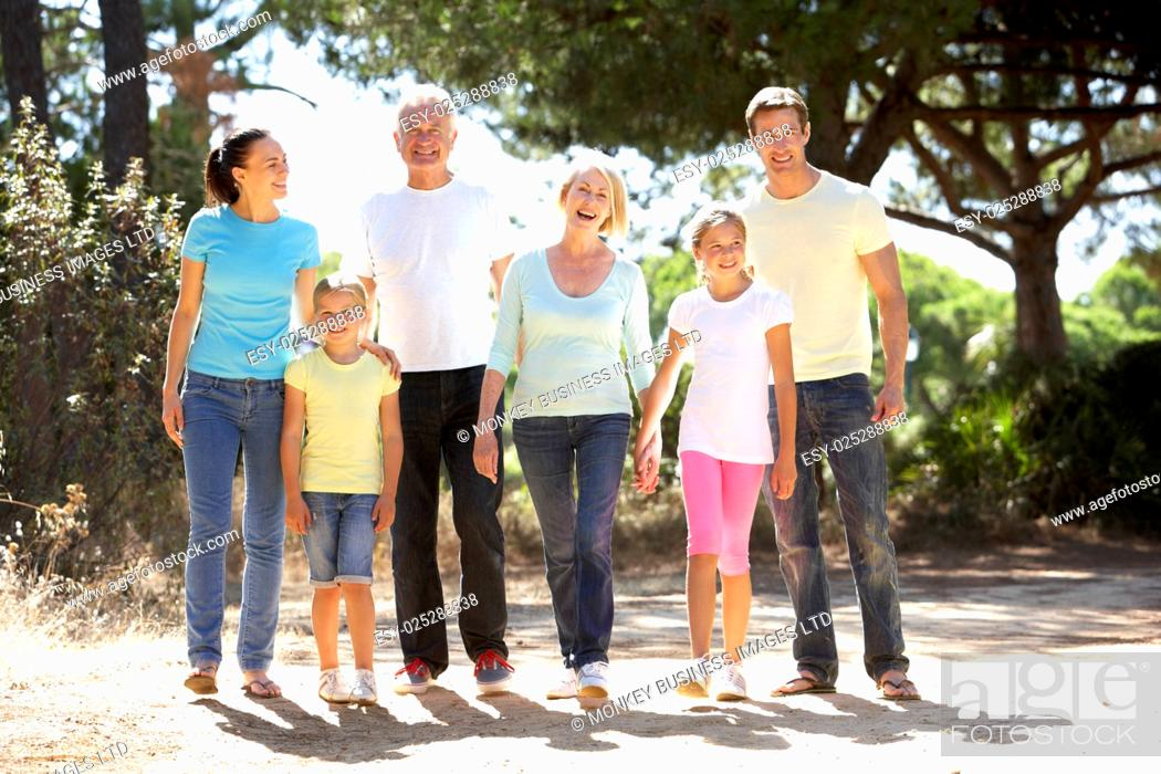 Stock Photo: Three Generation Family On Summer Countryside Walk Together.