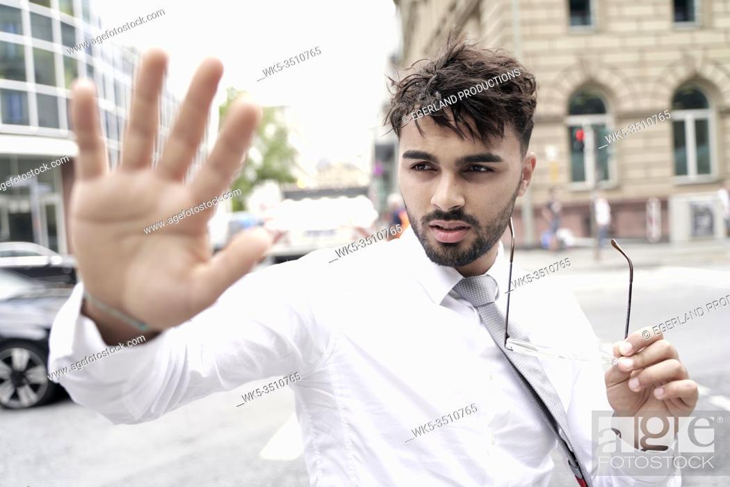 Photo de stock: Businessman on the street making stop gesture.