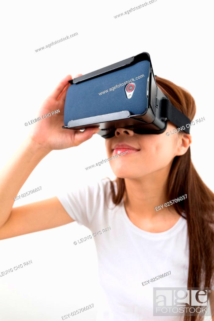Stock Photo: Young woman using virtual reality device.
