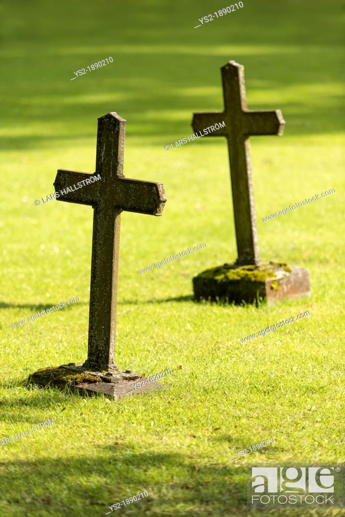 Stock Photo: Graves with christian cross.
