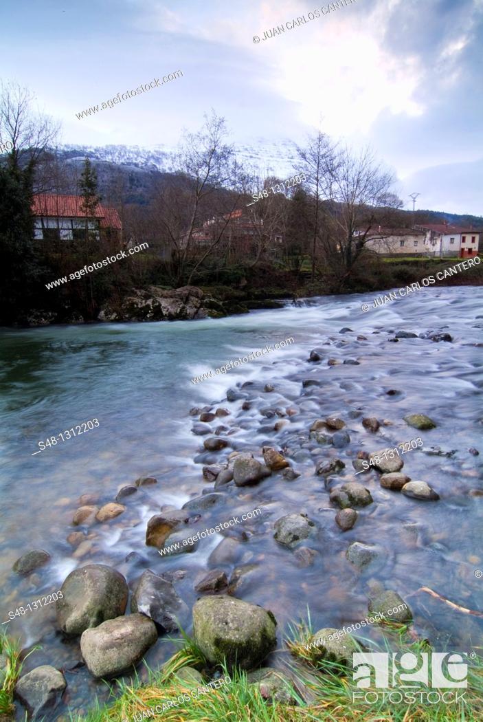Stock Photo: Ason River as it passes through Lastras, Cantabria, Spain.