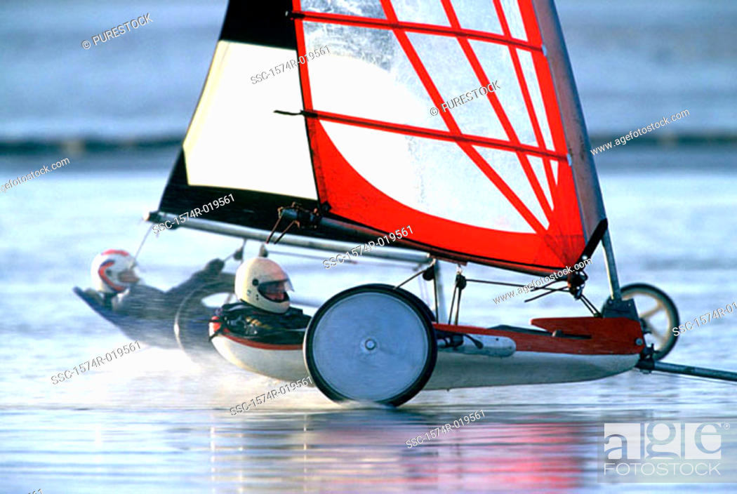 Stock Photo: Side profile of two people sailing on the beach.