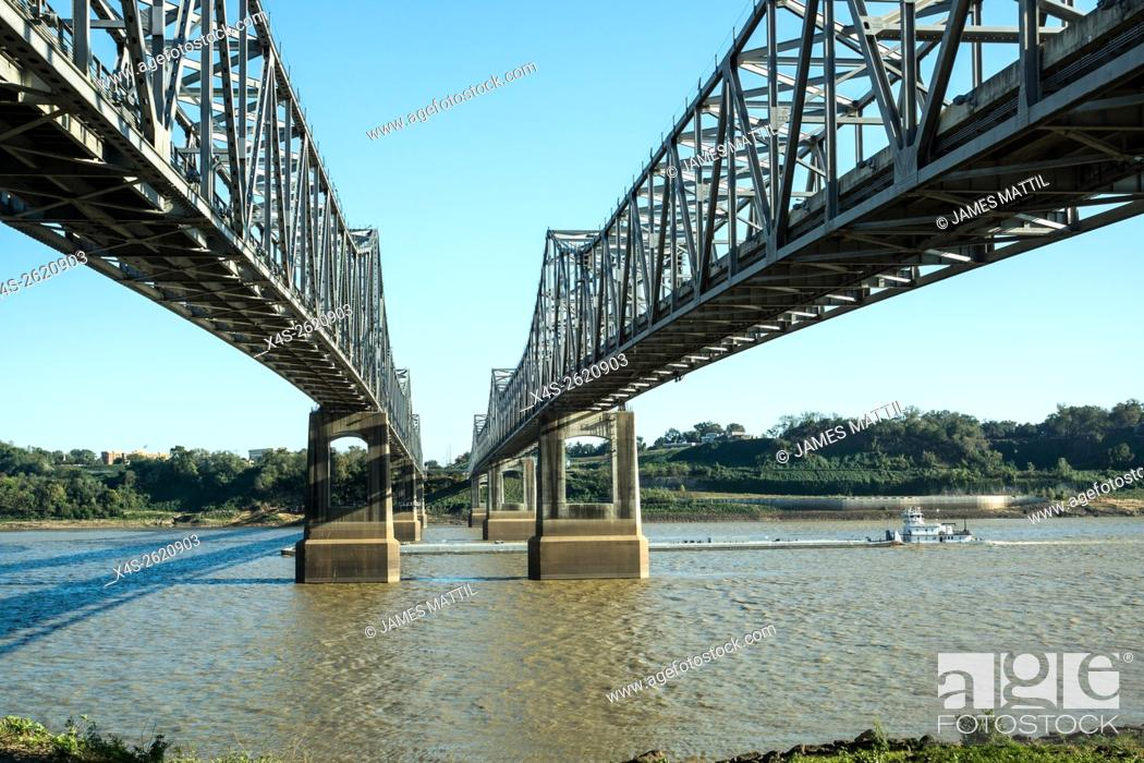 Stock Photo: A tug boat pushes a barge beneath the bridge over the Mississippi at Natchez, TN. Tub.