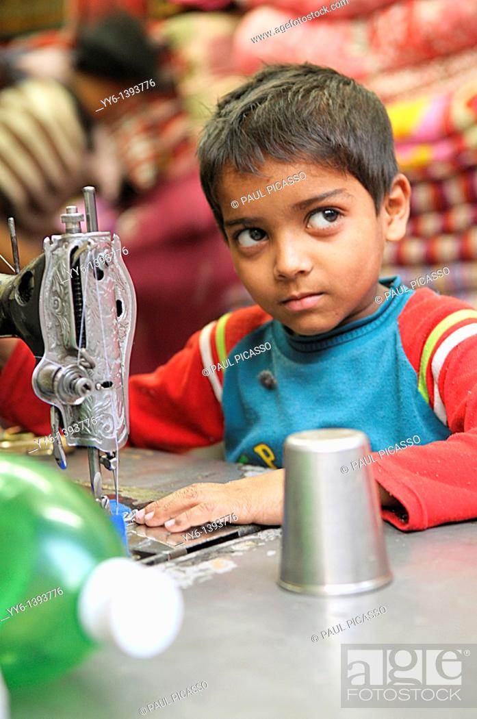 Stock Photo: child labourer, young boy sewing , the nepalis , life in kathmandu , kathmandu street life , nepal.