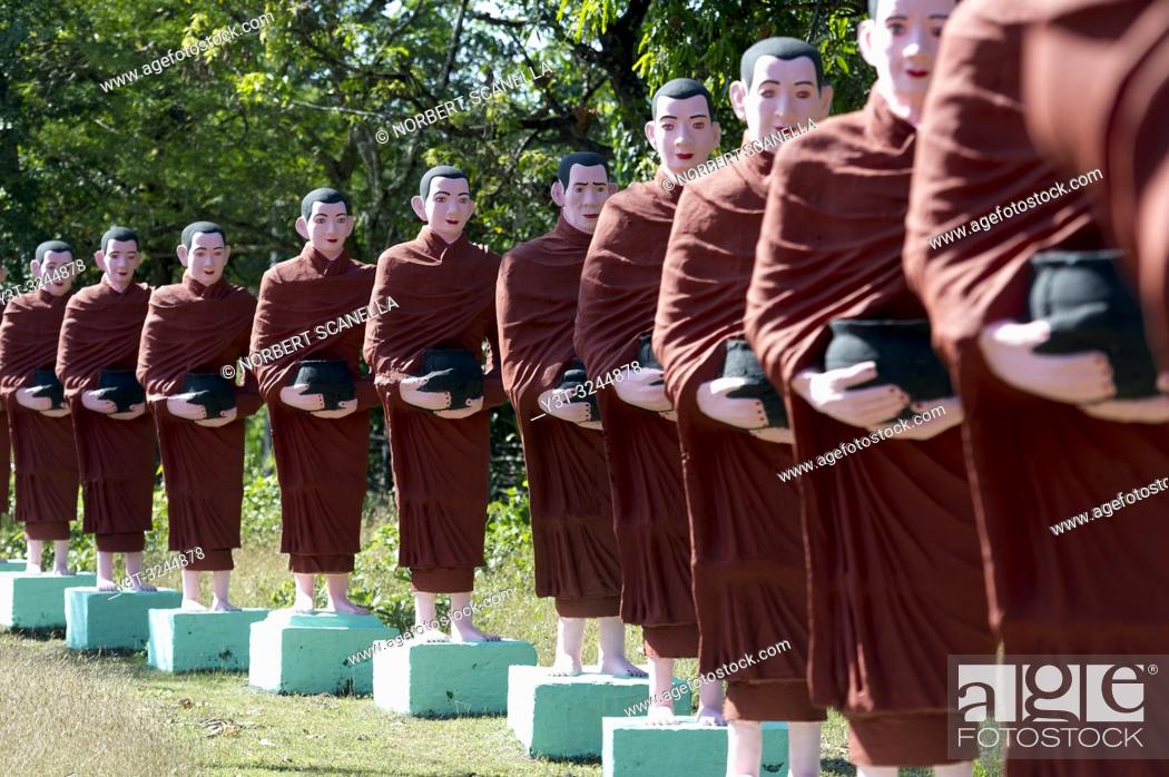 Stock Photo: Myanmar (formerly Burma). Mon State. Yadana Daung Mawlamyine (Moulmein) surroundings, Win Sein Taw Ya temple. Row of statues of the 500 Arahant followers of.