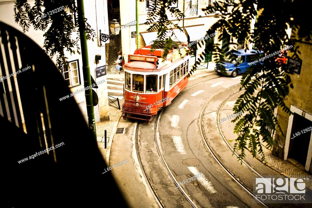 Stock Photo: Red tram in Lisbon, Portugal.