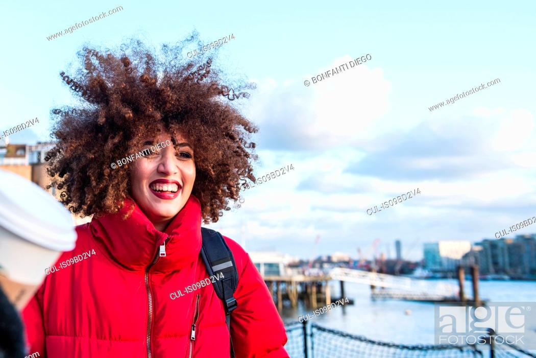 Stock Photo: Portrait of young girl, outdoors, smiling, London, England, UK.