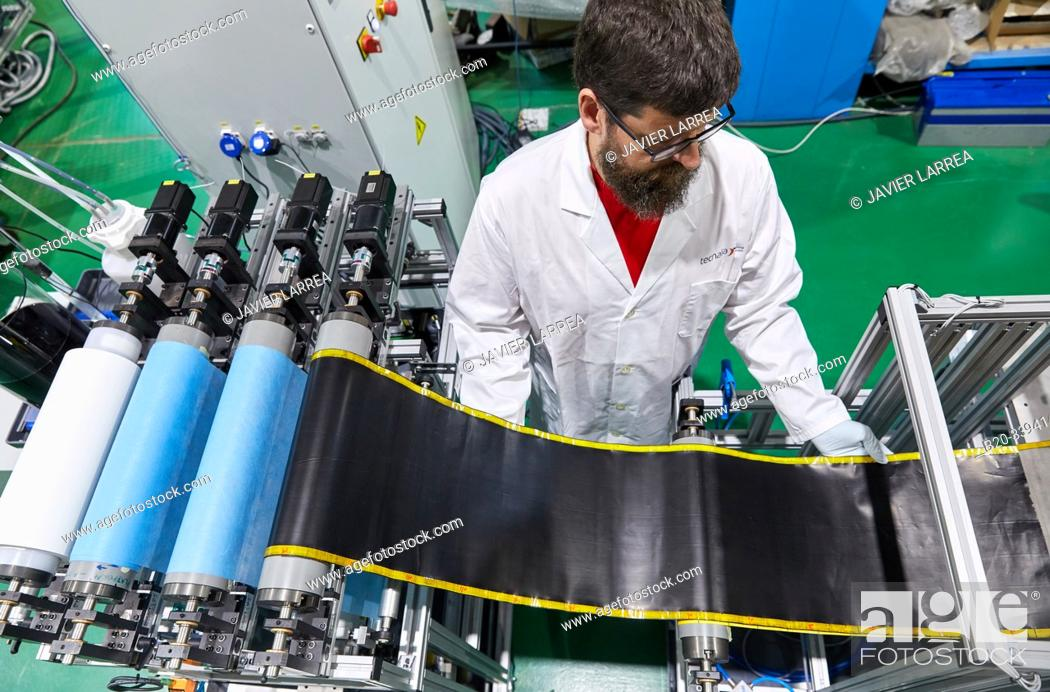 Stock Photo: Buckypapers continuous manufacturing plant, sheets composed of carbon nanotubes, based on a safe-by-design concept. Carbon nanotubes have extraordinary.