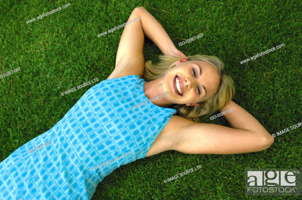 Stock Photo: Girl lying on grass.