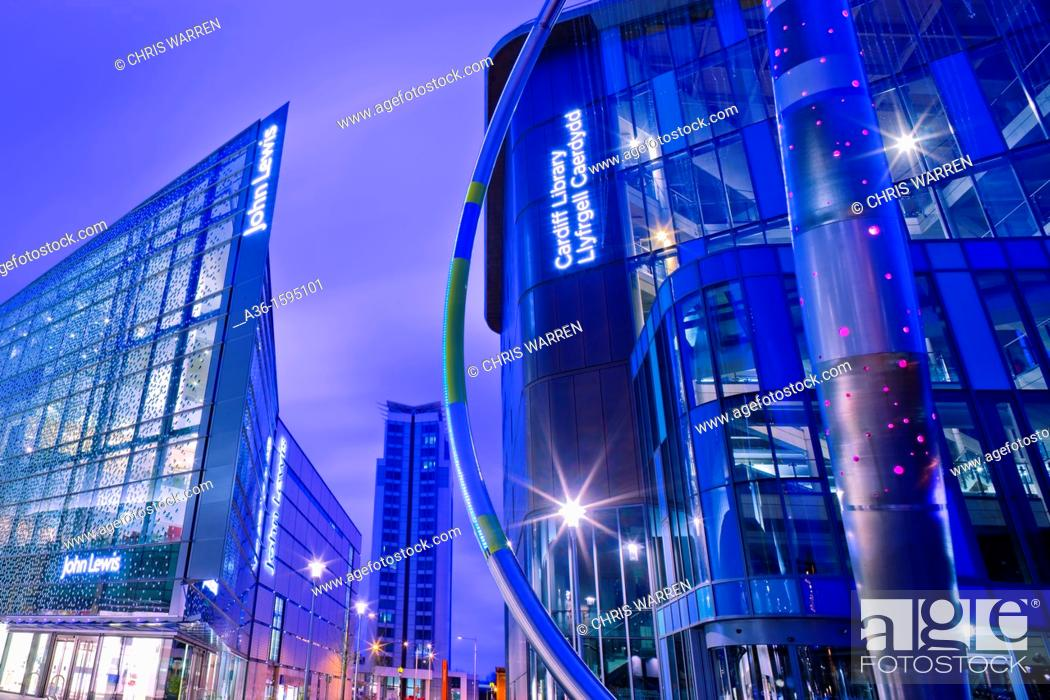 Stock Photo: John Lewis Store Shopping Centre and Central Library Cardiff Wales at twilight.
