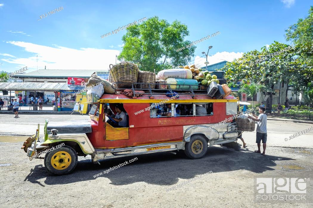 Stock Photo: Overloaded jeepney starting the journey at Puerto Princesa bus station, Palawan, Philippines.