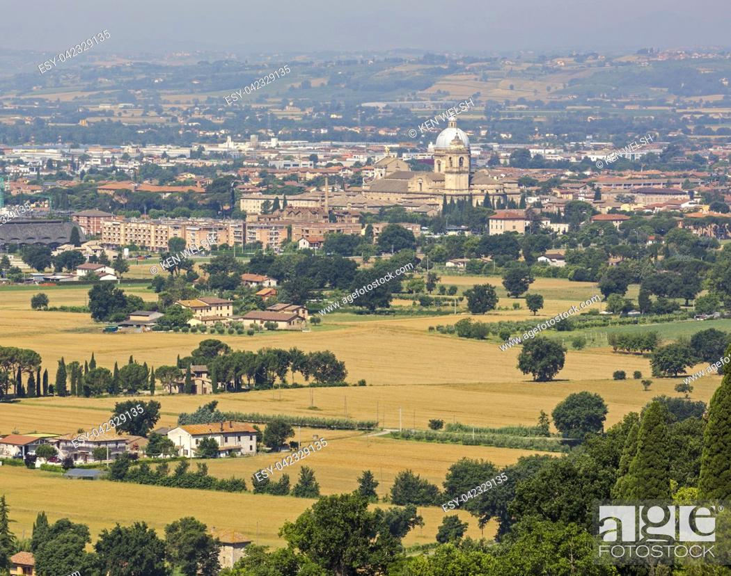 Stock Photo: Assisi, Perugia Province, Umbria, Italy. The Papal Basilica of Santa Maria degli Angelior Saint Mary of the Angels seen across the plain in front of Assisi.