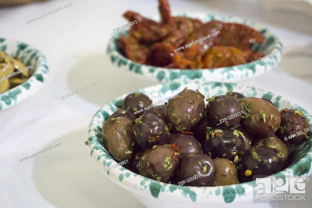 Stock Photo: Marinated olives with herbs.