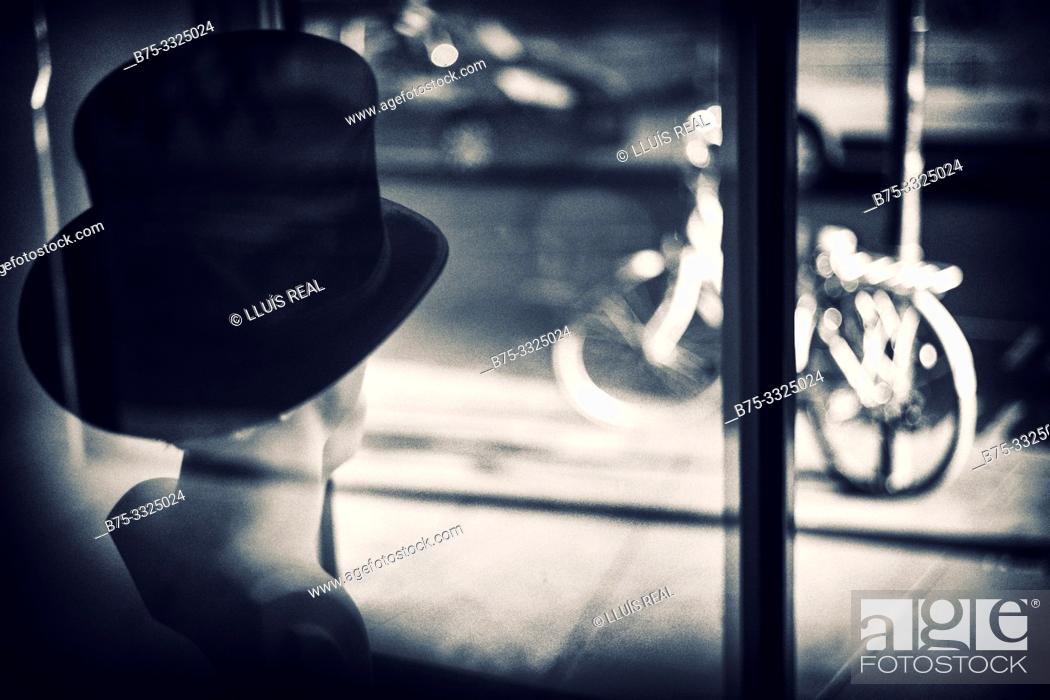 Stock Photo: Outdoor view from a hat shop window and a bicycle on London Street, UK, Europe.