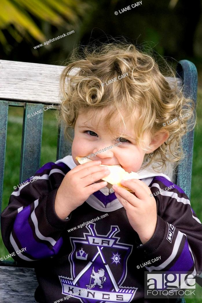Stock Photo: Toddler eating sandwich.