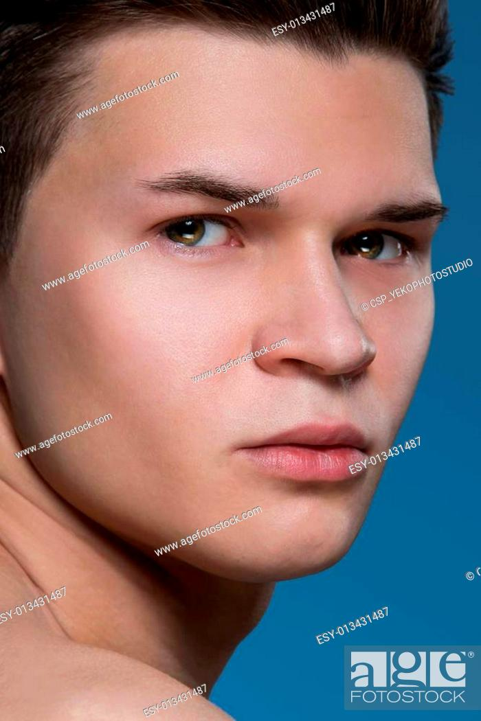 Stock Photo: Handsome man on blue background.