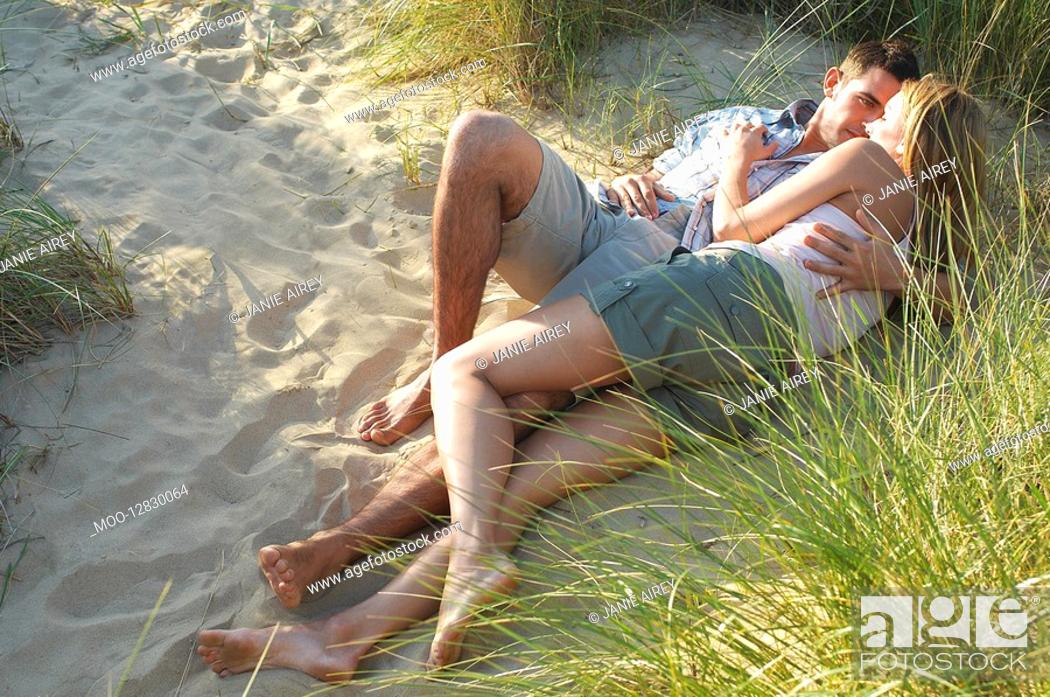 Stock Photo: Couple lying and embracing in Secluded Spot on Beach high angle view.