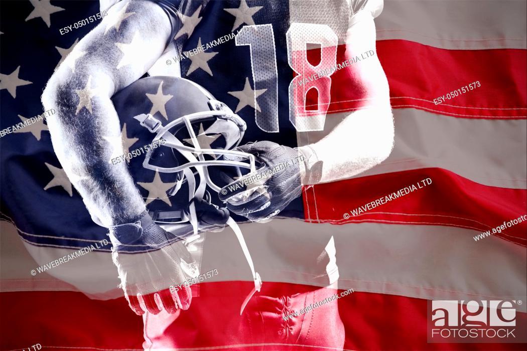Photo de stock: Full frame of wrinkled American flag against american football player holding rugby helmet.