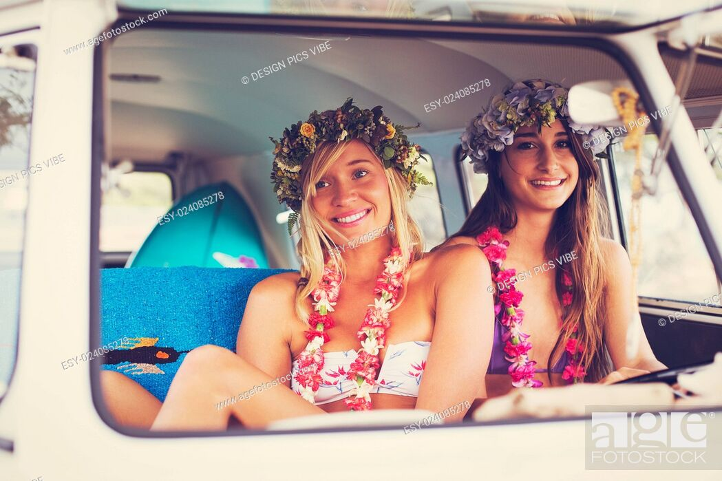 Stock Photo: Beach Lifestyle. Beautiful Young Surfer Girls Having Fun Hanging Out in Vintage Surf Van. Best Friends.