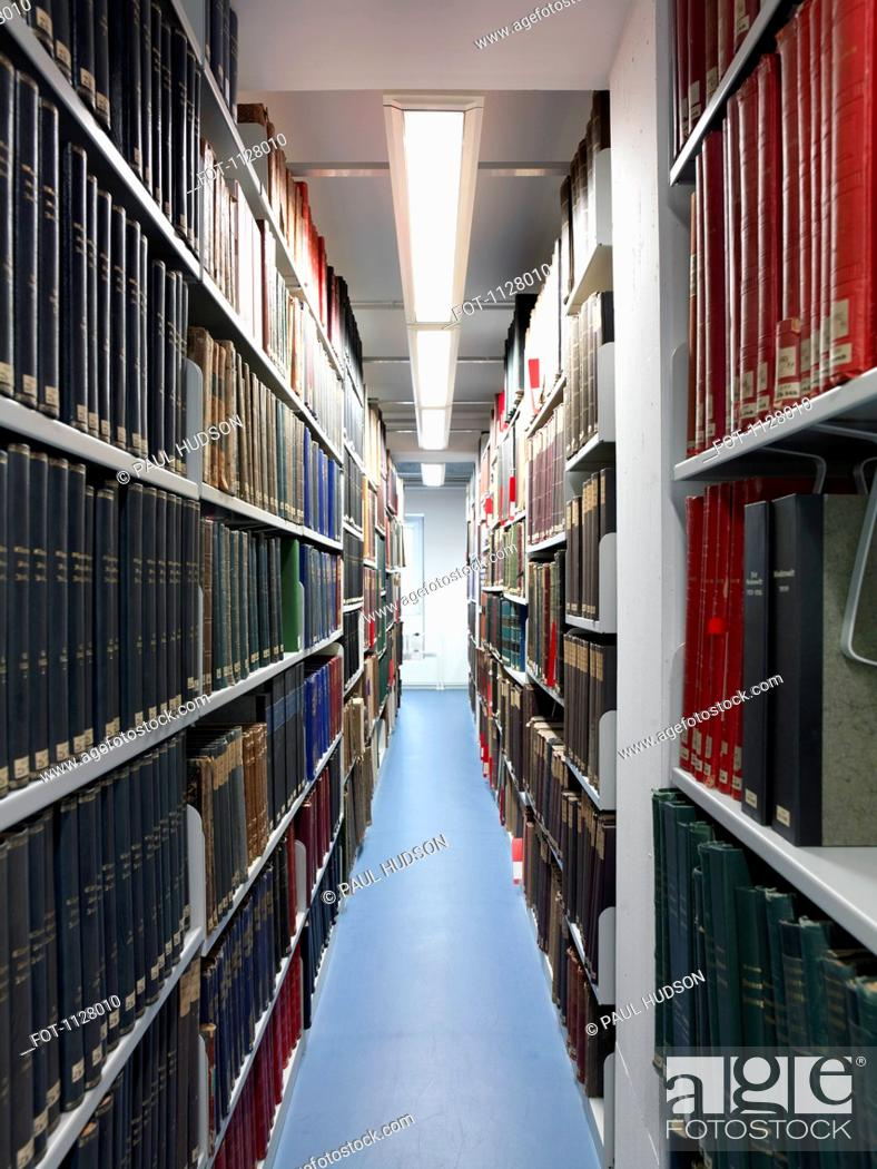 Stock Photo: View down an aisle in a library.