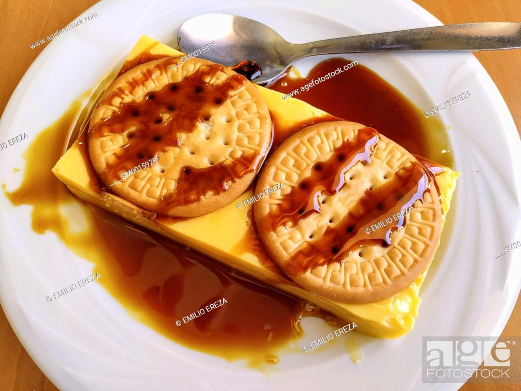 Stock Photo: Flan with cookies.