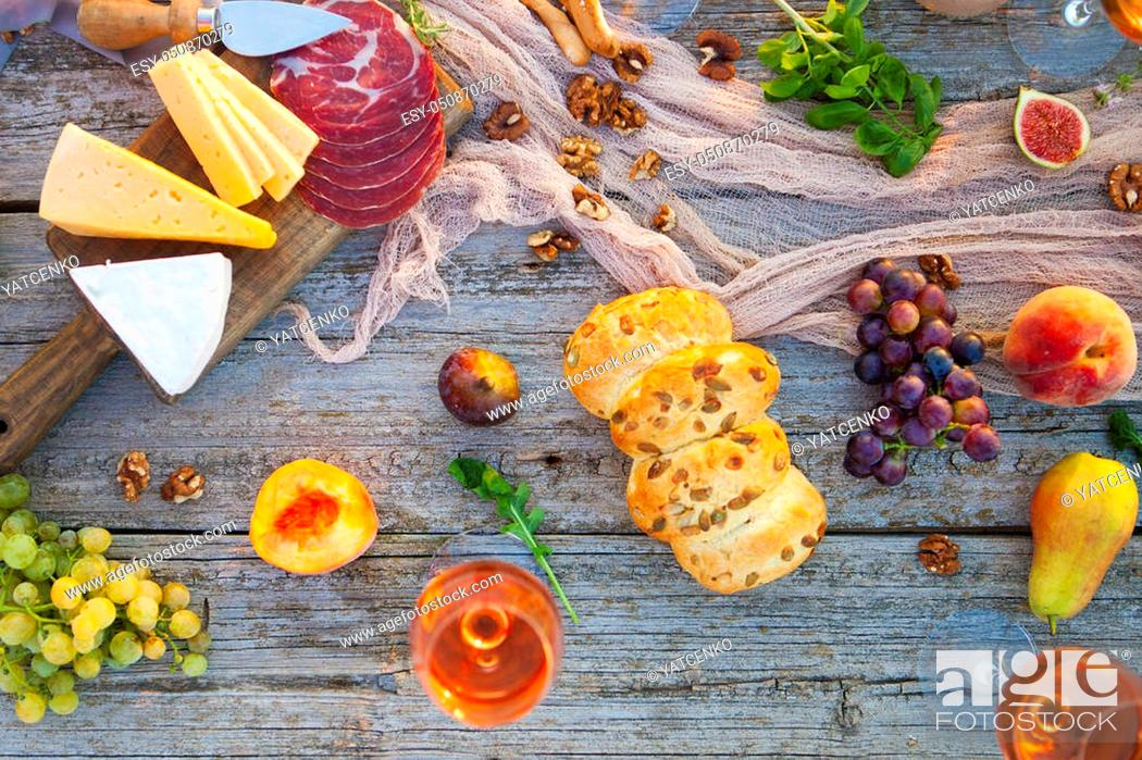 Stock Photo: Picnic on the beach at sunset in the style of boho, food and drink conception.