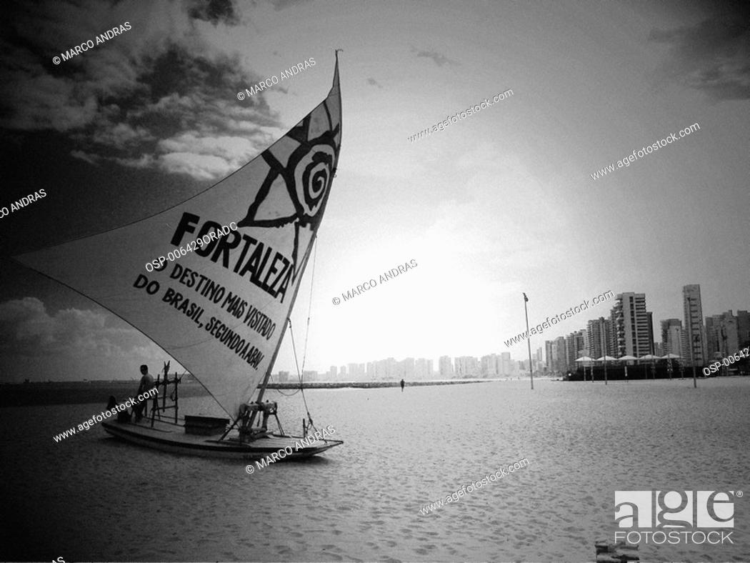Stock Photo: a raft boat sailing with fortaleza tribute sail.