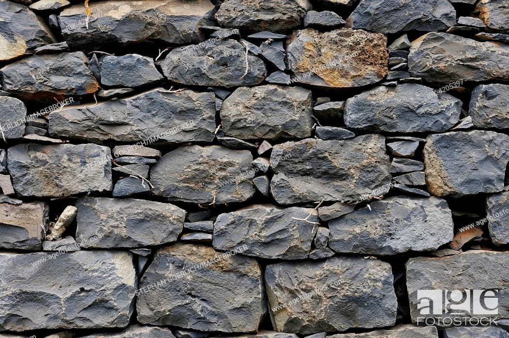 Stock Photo: Stone wall, piled stones, Madeira, Portugal.