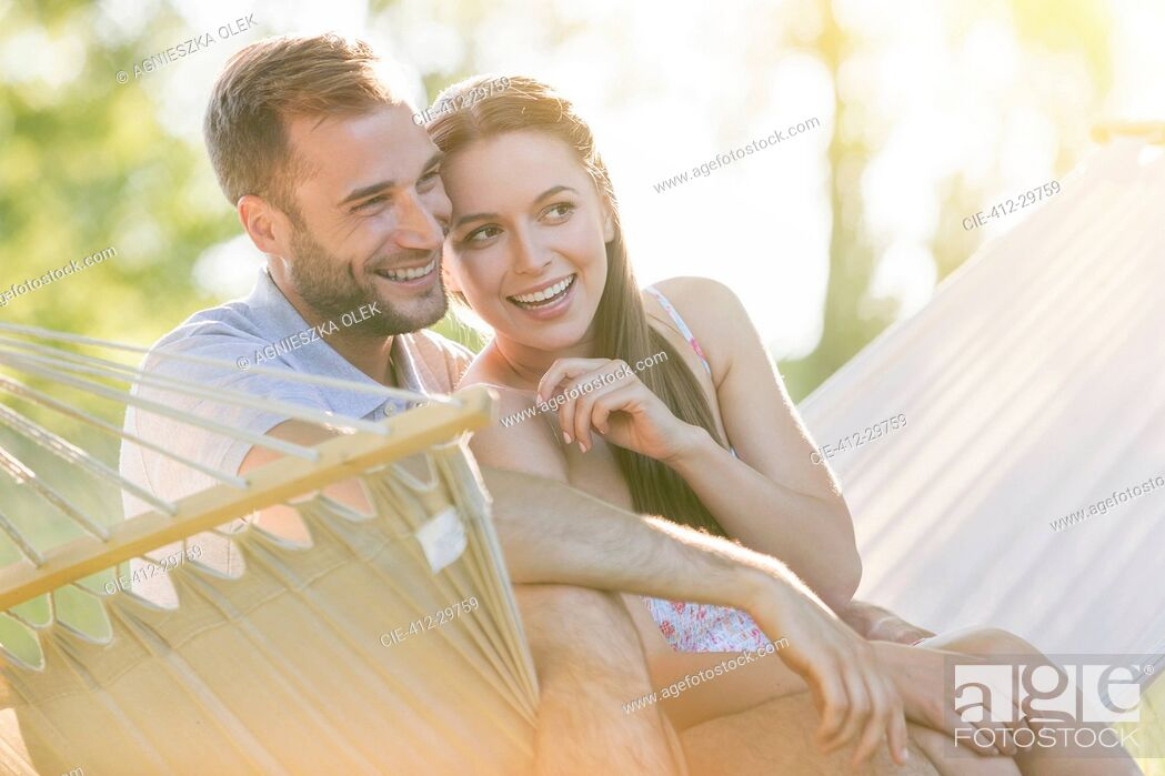 Stock Photo: Affectionate young couple smiling in summer hammock.