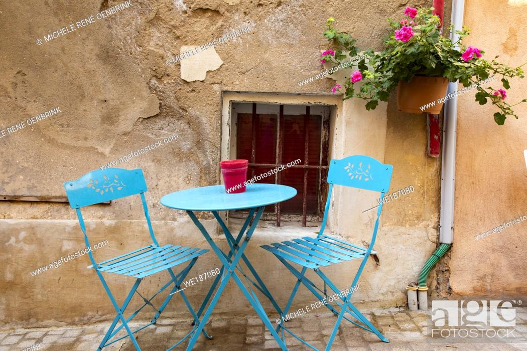 Stock Photo: Traditional table and chairs on street of Mediterranean fishing port of Cassis, France, .