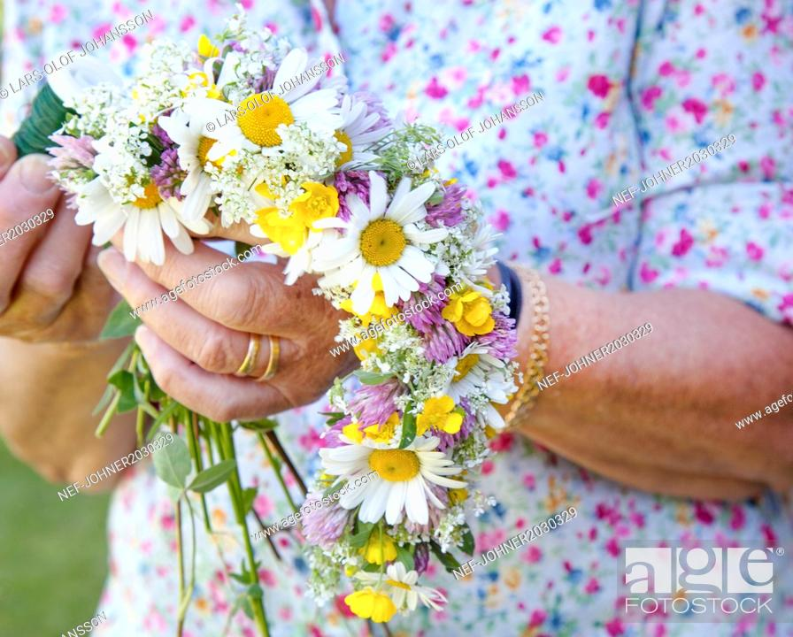 Senior Woman Making Flower Garland Close Up Stock Photo Picture