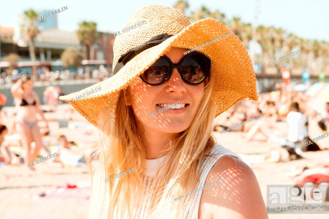 Stock Photo: Portrait of woman on beach, Barcelona, Catalonia, Spain.
