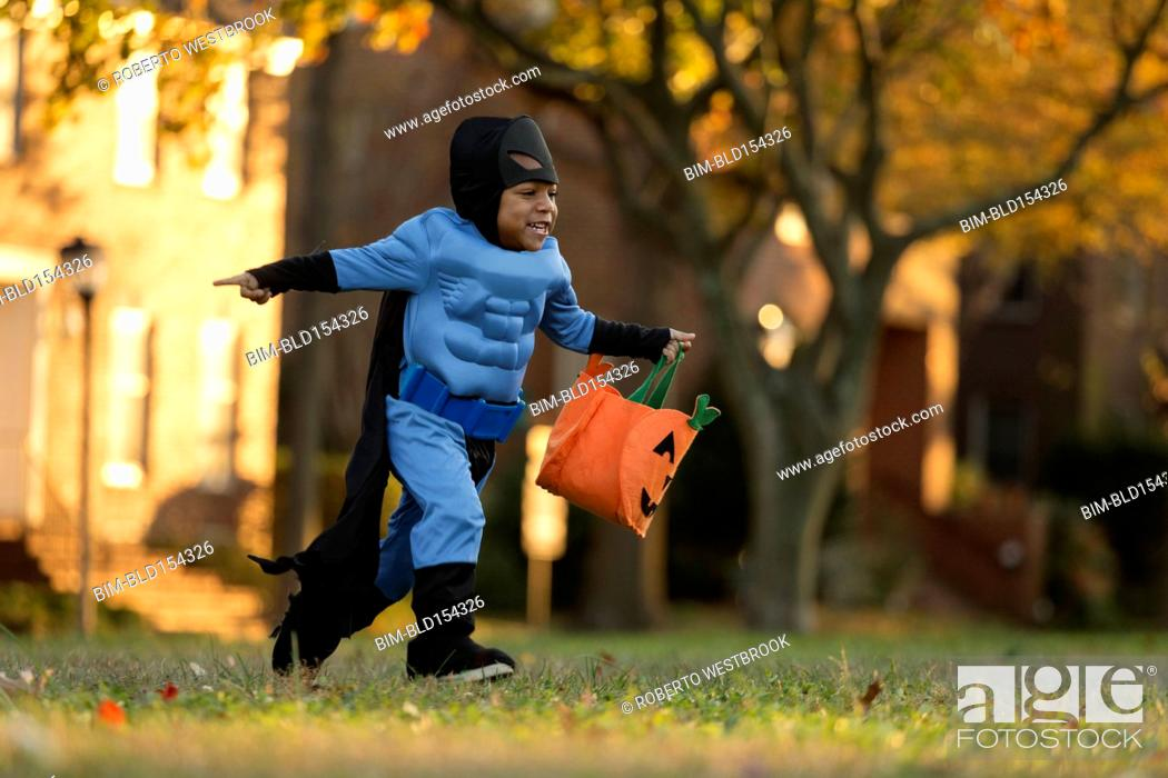 Stock Photo: African American boy trick-or-treating on Halloween.