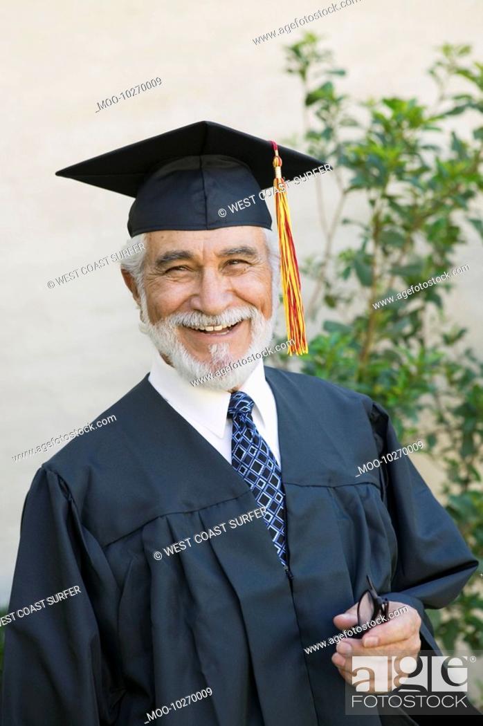 Stock Photo: Senior graduate smiling outside portrait.