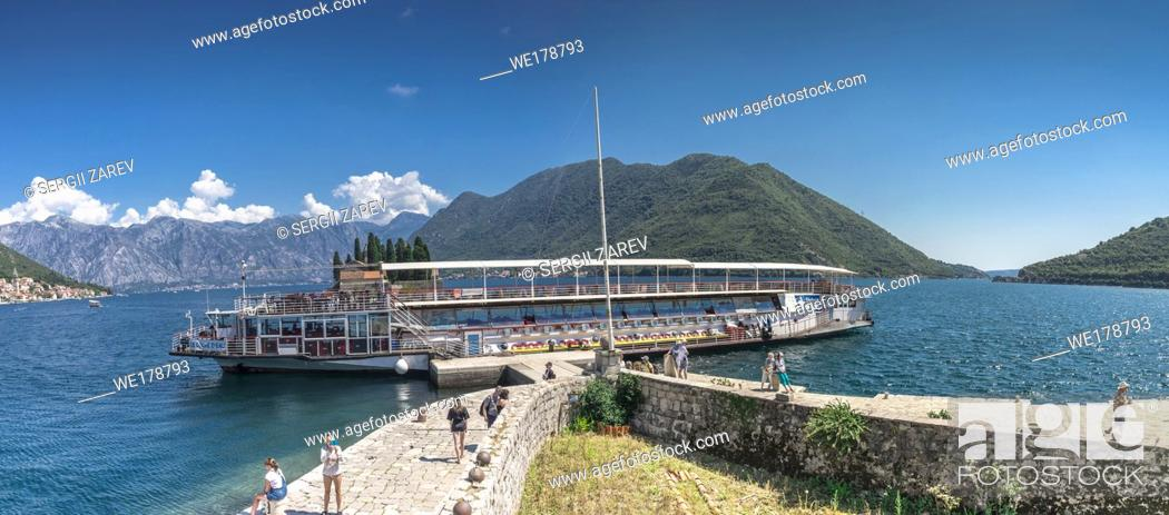 Stock Photo: Perast, Montenegro - 07. 11. 2018. Walking ship near Our Lady of the Rocks church on an Island in the Bay of Kotor, Montenegro.
