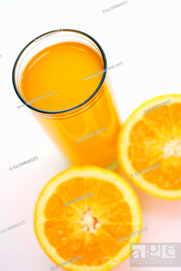 Stock Photo: High angle view of a glass of juice with lemon slices.