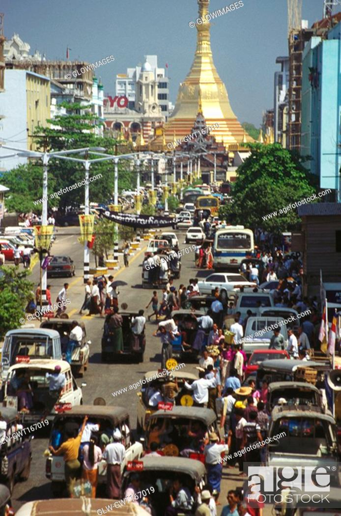 Stock Photo: High angle view of traffic on the road with a pagoda in the background, Sule Pagoda, Yangon, Myanmar.