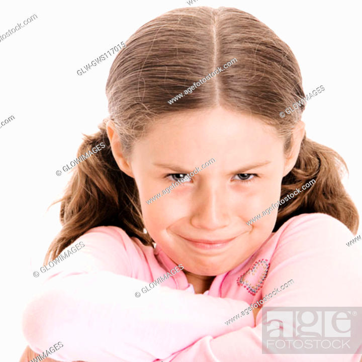 Stock Photo: Portrait of a girl with her arms folded.
