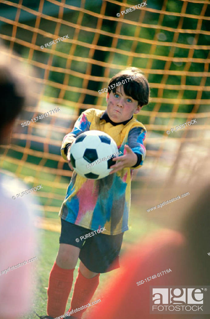 Stock Photo: Goalie holding a soccer ball.