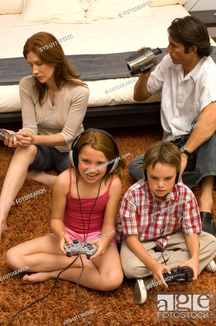 Stock Photo: Portrait of a family enjoying technology.