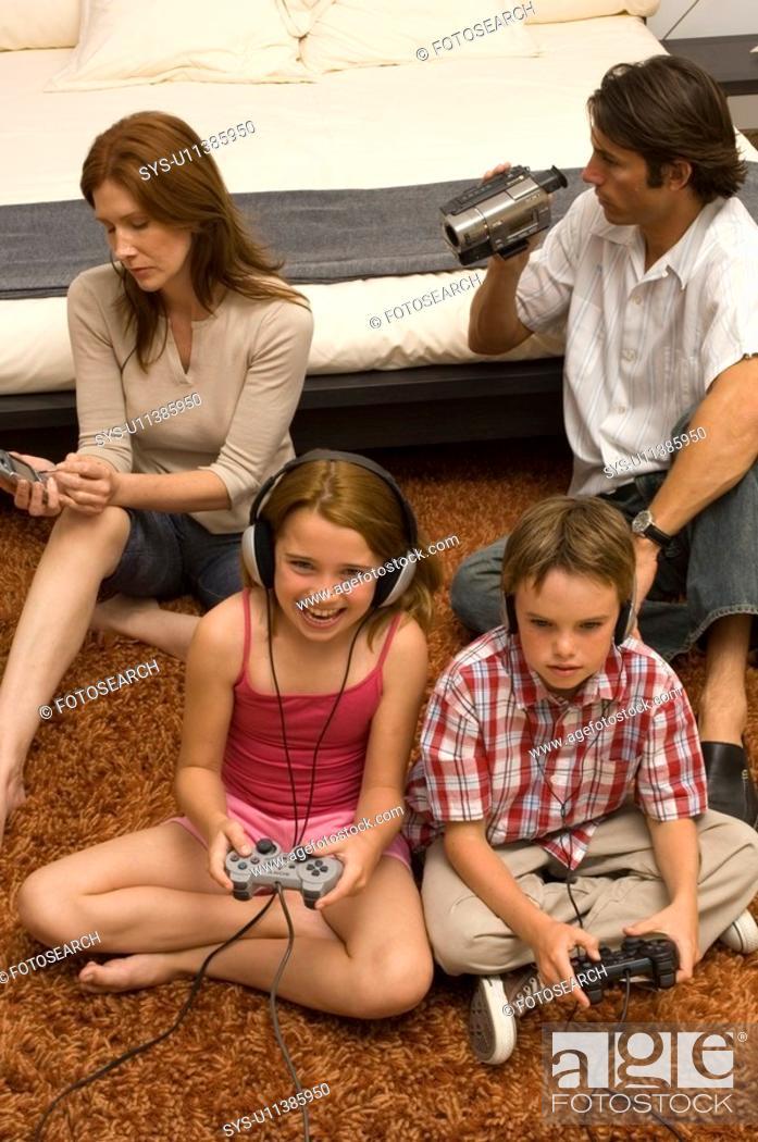 Stock Photo: Portrait of a family enjoying technology.
