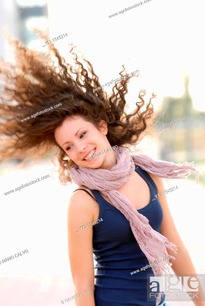 Stock Photo: Cute teen moving her long curly hair.