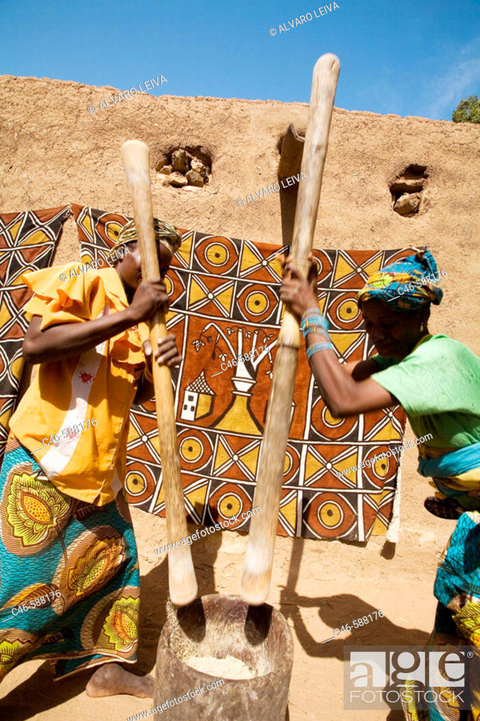 Stock Photo: Women grinding millet, Segou, Mali, Africa.