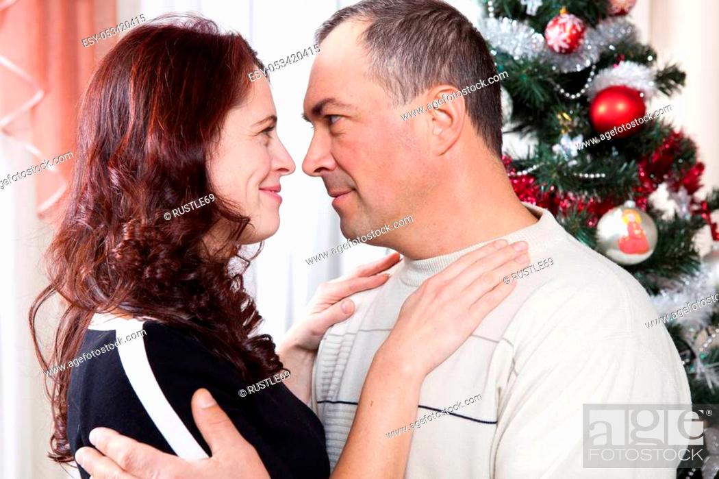 Stock Photo: Christmas Couple. Happy Smiling Family at home celebrating. New Year People.